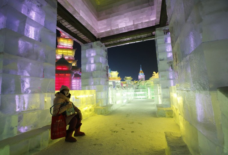 A visitor sits inside an ice sculpture at the Harbin Ice and Snow Sculpture Festival in the northern city of Harbin, Heilongjiang province, China, on January 5, 2014. (Kim Kyung-Hoon/Reuters)