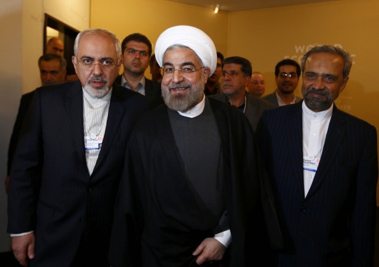Iran's President Hassan Rouhani, Foreign Minister Mohammad Javad Zarif (L) and Mohammad Nahavandian the Head of Iran Presidential Office (R) arrive for a meeting during the annual meeting of the World Economic Forum (WEF) in Davos January 22, 2014. (REUTERS/Denis Balibouse)