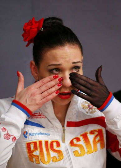 Alena Leonova of Russia wipes off tears after the Ladies Free Skating at the ISU European Figure Skating Championships in Budapest, January 17, 2014. REUTERS/Laszlo Balogh