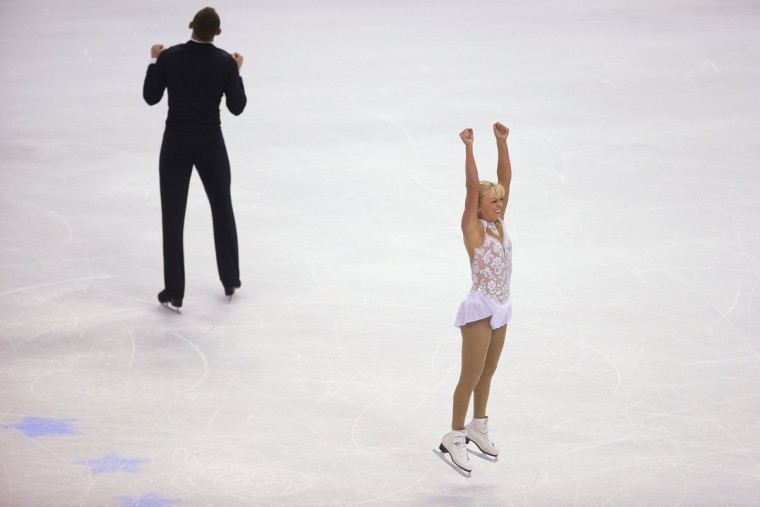 Caydee Denney and John Coughlin (L) react after finishing their program in the pairs free skate competition at the U.S. Figure Skating Championships in Boston, Massachusetts January 11, 2014. (REUTERS/Brian Snyder)