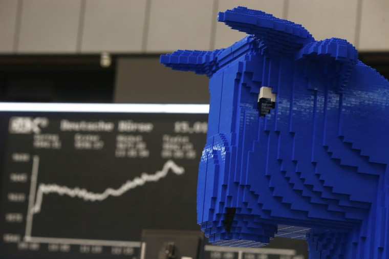A bull figure made of 210,000 pieces of LEGO bricks, stands in front of the German share price index DAX board at the German stock exchange in Frankfurt. (Ralph Orlowski/Reuters)