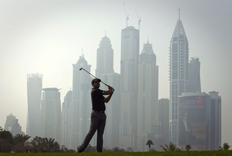 Tiger Woods of the U.S. watches his shot on the 13th fairway during the second round of the 2014 Omega Dubai Desert Classic in Dubai January 31, 2014. (REUTERS/Caren Firouz)
