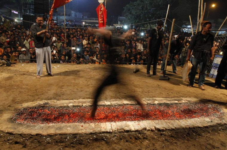 Hot coals in India: Shi'ite Muslims take part in a ceremony to mark the religious ritual of Arbain, in the western Indian city of Ahmedabad on December 24, 2013. Shi'ite Muslims commemorate Arbain, to mark the end of a 40-day period of mourning for the Imam Hussein, Prophet Mohammad's grandson, who died in AD 680. (REUTERS/Amit Dave)