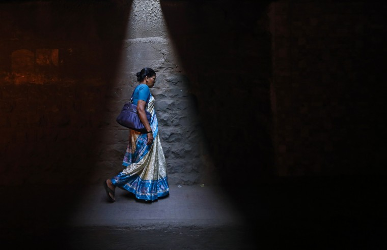 A woman walks through a subway under railways tracks in Mumbai January 7, 2014. (Danish Siddiqui/Reuters)