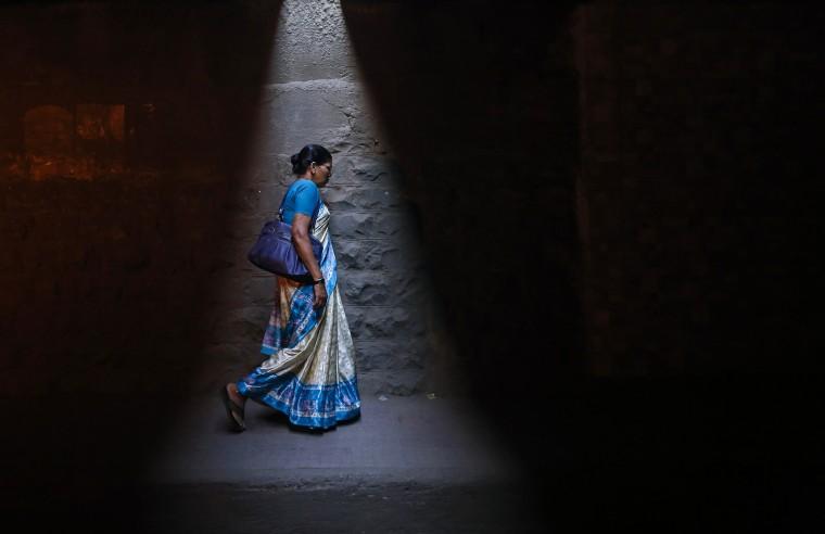 A woman walks through a subway under railways tracks in Mumbai January 7, 2014. (Danish Siddiqui/Reuters)