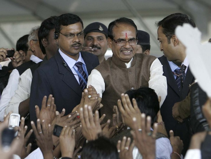 BJP meeting: Shivraj Singh Chouhan (second from right), chief minister of Madhya Pradesh, greets his Bharatiya Janata Party (BJP) supporters during Chouhan's swearing-in ceremony in the central Indian city of Bhopal December14, 2013. A month after the party's return to power in multiple parts of government, the ruling BJP is set to hold its first state-executive meeting from Jan. 6 to Jan. 8 at its party headquarters, according to The Times of India. (REUTERS/Raj Patidar)