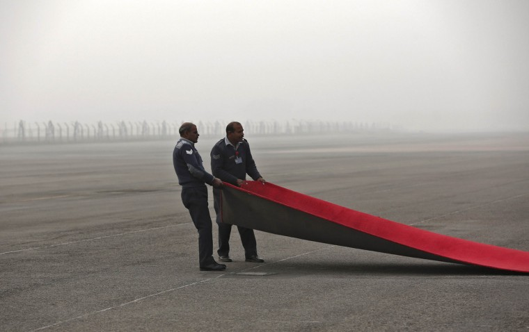 Indian Air force officials put the red carpet in place before South Korean President Park Geun-Hye's arrival at the airport airport in New Delhi. Geun-Hye is on a four-day state visit to India. (Adnan Abidi/Reuters)