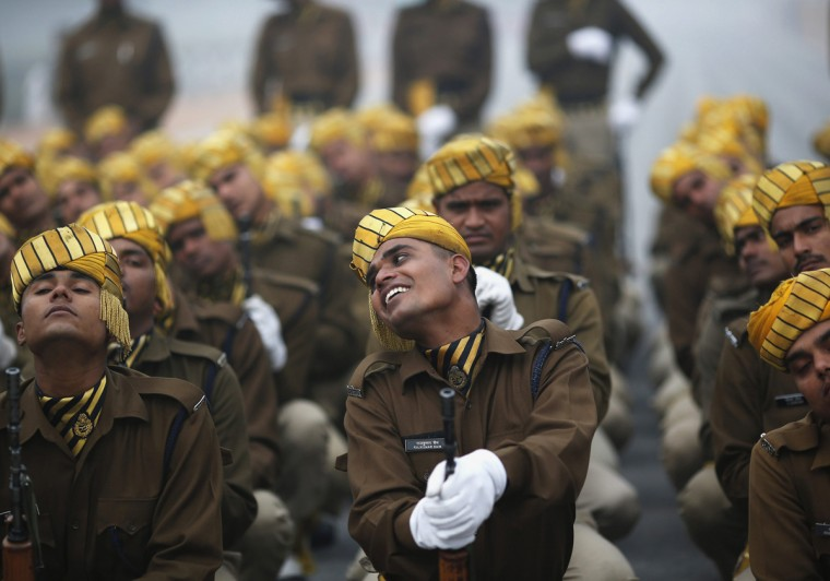 Indian soldiers take part in the rehearsal for the Republic Day parade amid fog on a cold winter morning in New Delhi January 6, 2014. India will celebrate its annual Republic Day on January 26. (Ahmad Masood/Reuters)