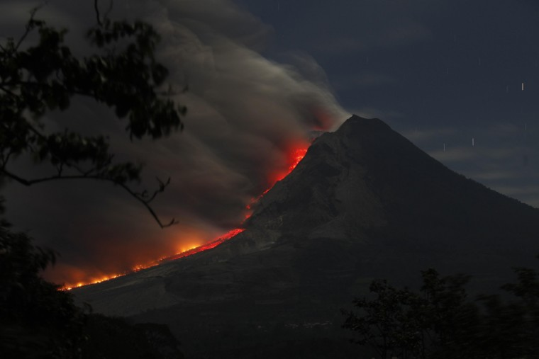 Mount Sinabung volcano spews ash as seen from Kuta Tengah village in Karo district, Indonesia's North Sumatra province, January 14, 2014. More than 25,000 villagers have been evacuated since authorities raised the alert status for the volcano to the highest level in November 2013, local media reported on Monday. (YT Haryono/Reuters)