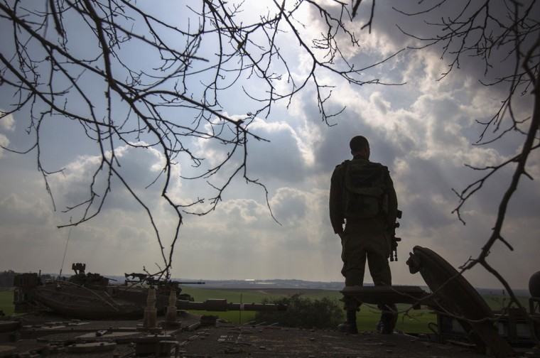An Israeli soldier stands atop an armoured personnel carrier (APC) on the border with northern Gaza January 17, 2014. REUTERS/Amir Cohen