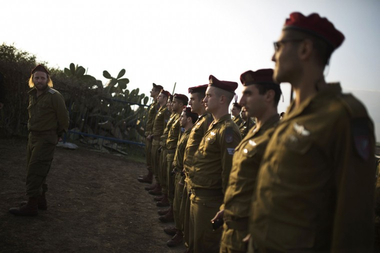 Israeli soldiers from a paratrooper unit once commanded by former Israeli Prime Minister Ariel Sharon rehearse to serve as the honor guard at his funeral on Monday in southern Israel, January 12, 2014. Sharon died on Saturday at age 85, after eight years in a coma caused by a stroke. (Amir Cohen/Reuters)