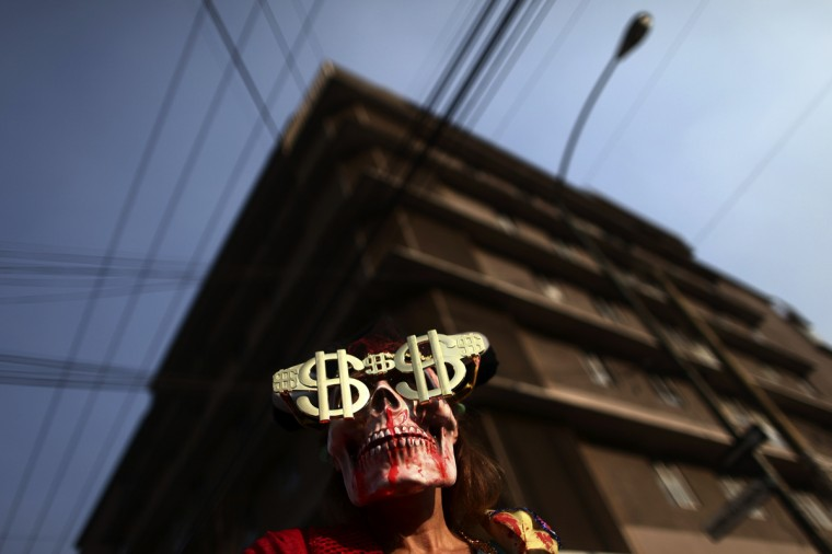 An activist takes part during a demonstration against bullfighting outside La Mexico bullring in Mexico City January 5, 2014. (Edgard Garrido/Reuters)