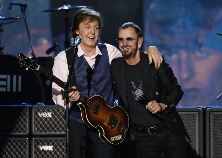 "Paul McCartney (L) and Ringo Starr perform during the taping of ""The Night That Changed America: A GRAMMY Salute To The Beatles"", which commemorates the 50th anniversary of The Beatles appearance on the Ed Sullivan Show, in Los Angeles January 27, 2014. (Mario Anzuoni/Reuters)"
