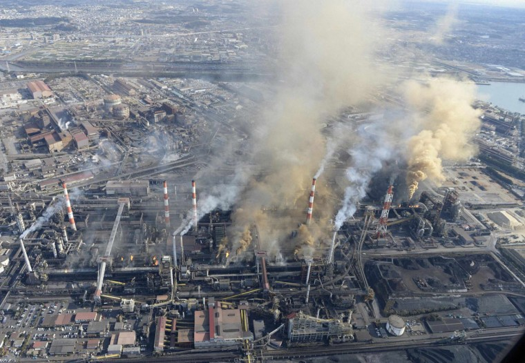Fire and smoke spew out from multiple spots at Nippon Steel & Sumitomo Metal Corp's Nagoya steel plant in Tokai, central Japan, in this aerial view photo taken by Kyodo January 17, 2014. A fire erupted at Nippon Steel & Sumitomo Metal Corp's steel plant in central Japan, local fire authorities said on Friday, adding no injuries have been reported. REUTERS/Kyodo