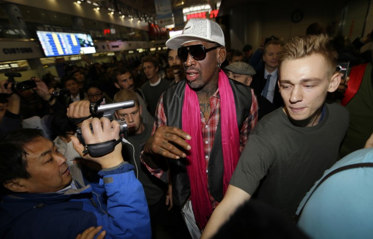 Former NBA basketball player Dennis Rodman (C) is surrounded by journalists as he arrives at the Beijing Capital International Airport to leave for Pyongyang, in Beijing, January 6, 2014. Rodman was reportedly returning to North Korea for an exhibition match to be played to coincide with birthday celebrations of the secretive state's leader, Kim Jong Un. Rodman will lead a team of former National Basketball Association (NBA) stars for the game. (Jason Lee/Reuters)