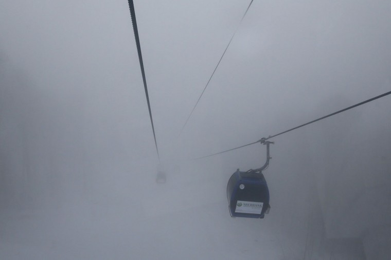 A gondola ascends on a foggy day near the Rosa Khutor alpine resort near Sochi January 31, 2014. Preparations continue for the 2014 Winter Olympic Games that will be held in Sochi. (REUTERS/Stefan Wermuth)