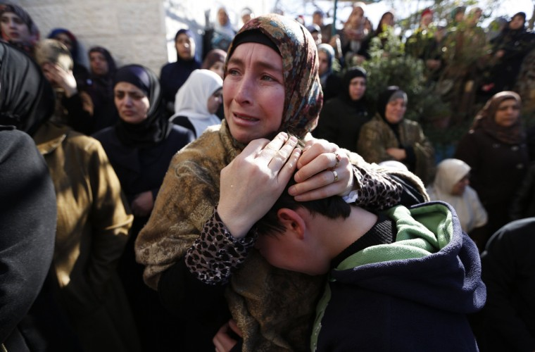 Palestinian relatives mourn during the funeral of Muhammad Mubarak, 21, in Jalazoun refugee camp near the West Bank city of Ramallah. Israeli soldiers killed Mubarak on Wednesday who the military said had opened fire on their position near a Jewish settlement in the occupied West Bank. (Mohamad Torokman/Reuters)