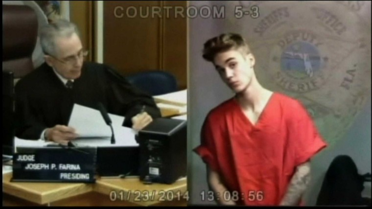Pop singer Justin Bieber appears in front of Judge Joseph Farina by video link in this still image from video from Miami, Florida January 23, 2014. Bieber was arrested in South Florida early on January 23 on a drunken driving charge after he was caught drag racing on a main thoroughfare in a rented yellow Lamborghini, police said. (Pool photo)
