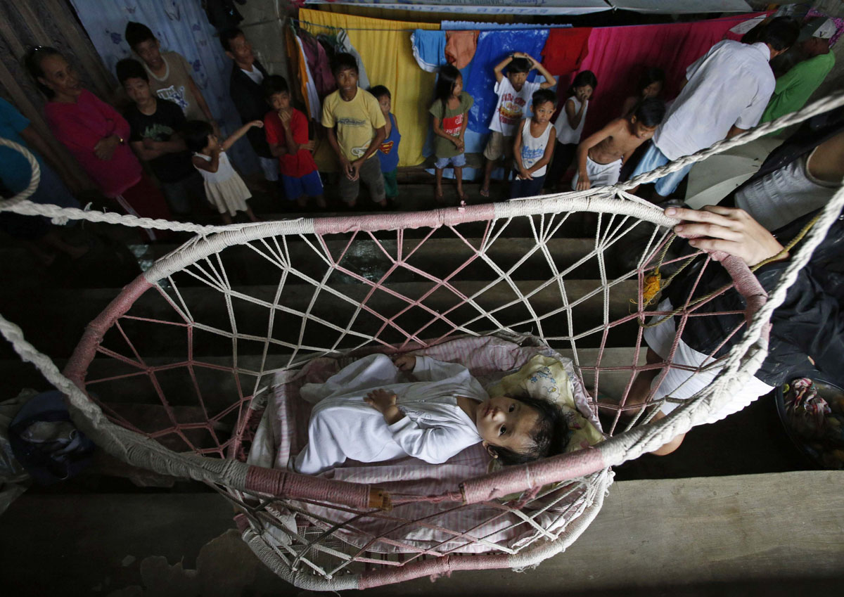 a baby rests on a hammock inside an indoor basketball gym in jabonga agusan del norte a baby rests on a hammock inside an indoor basketball gym in      rh   darkroom baltimoresun