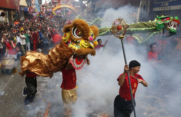 Filipino-Chinese people perform a dragon and lion dance during the Chinese New Year celebration in Manila's Chinatown January 31, 2014. According to the Chinese lunar calendar, the Chinese New Year, which welcomes the year of the horse, falls on January 31 this year. (REUTERS/Erik De Castro)