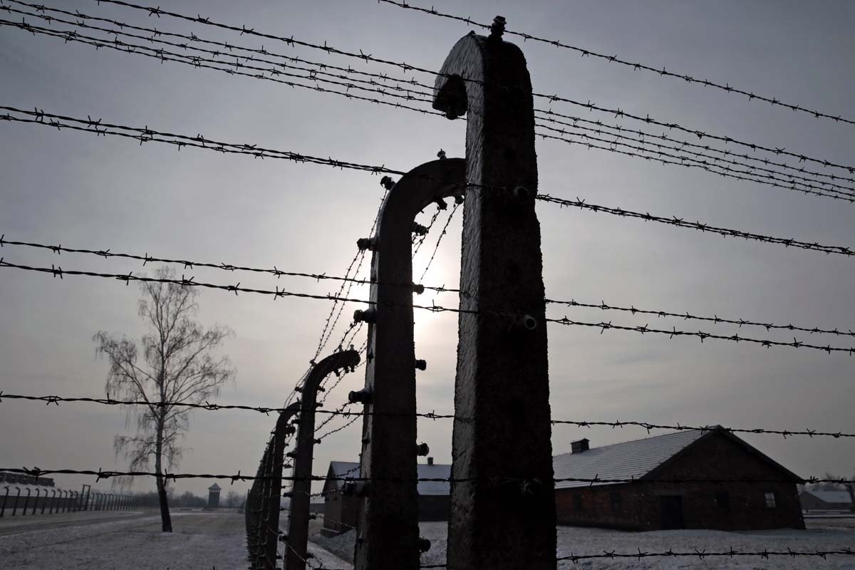 Former Auschwitz-Birkenau concentration camp is pictured through a ...