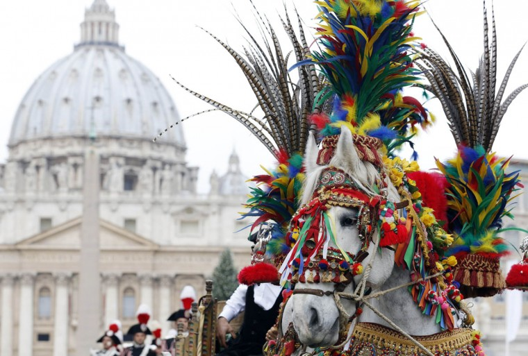 A traditional Sicilian chariot with a horse is seen in Saint Peter's Square at the Vatican January 17, 2014. Animals, including pigs, chickens, horses, cats and dogs, were at St. Peter's Square to mark the feast of St. Anthony the Abbot, the third-century holy man who is the Catholic Church's patron of animals. (REUTERS/Stefano Rellandini)