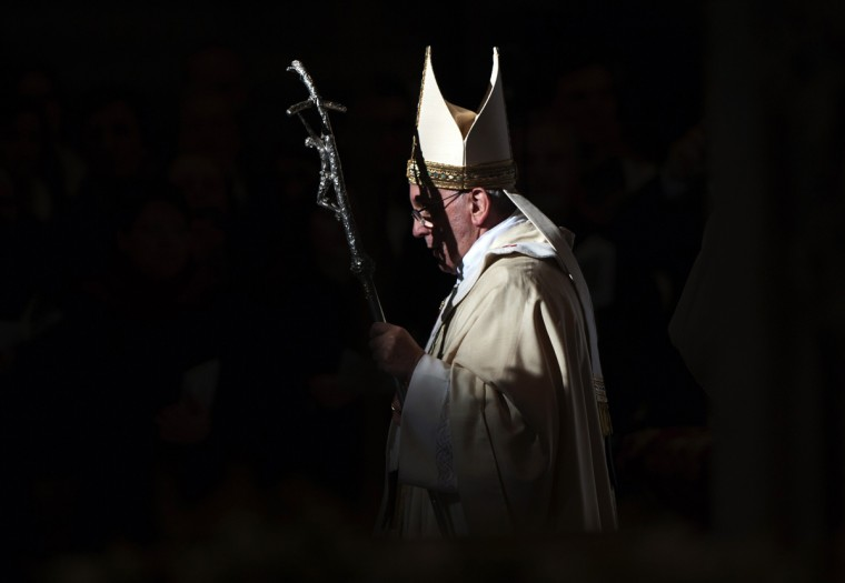 Pope Francis walks with his pastoral staff as he leads the Epiphany mass in Saint Peter's Basilica at the Vatican January 6, 2014. (Max Rossi/Reuters)