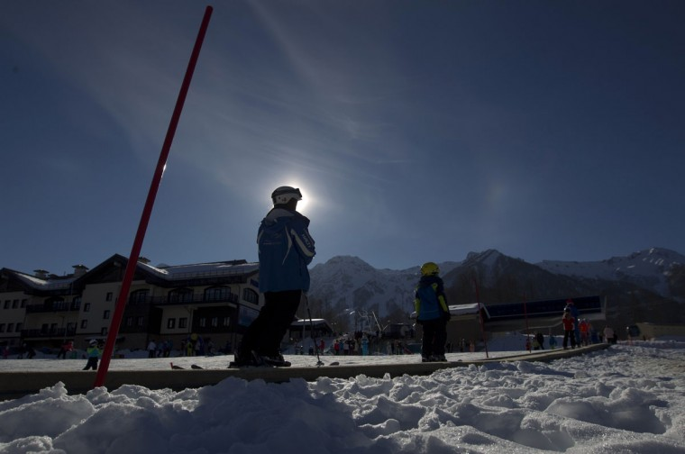 Visitors use a ski travelator on a slope near the resort of Krasnaya Polyana, near Sochi January 3, 2014. (REUTERS/Maxim Shemetov)