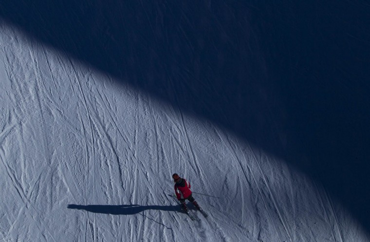 A visitor skies down a slope near the resort of Krasnaya Polyana, near Sochi January 3, 2014. (REUTERS/Maxim Shemetov)