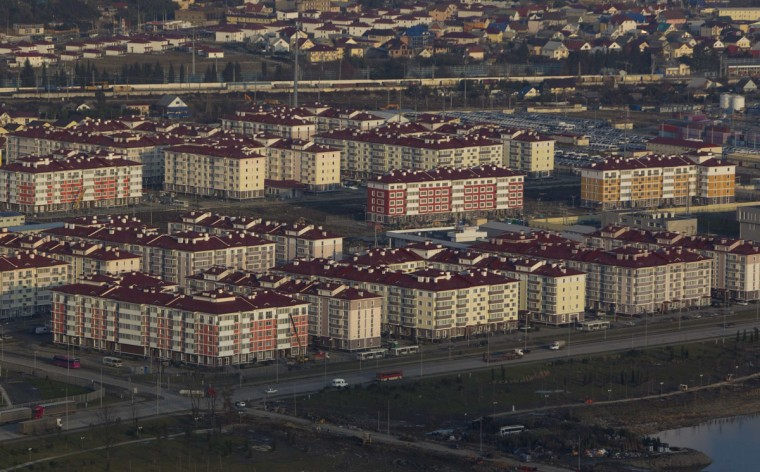 An aerial view from a helicopter shows residential houses recently constructed for the 2014 Winter Olympics in the Adler district of the Black Sea resort city of Sochi, December 23, 2013. Sochi will host the 2014 Winter Olympic Games in February. Picture taken December 23, 2013.