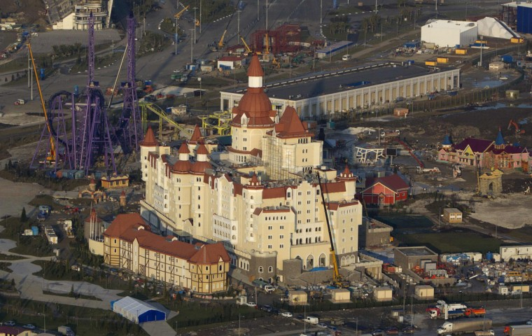 "An aerial view from a helicopter shows the ""Theme Park / Amusement Park"" (back) constructed by the JSC ""Sochi Park"" company in the Adler district of the Black Sea resort city of Sochi, December 23, 2013. Sochi will host the 2014 Winter Olympic Games in February. Picture taken December 23, 2013."
