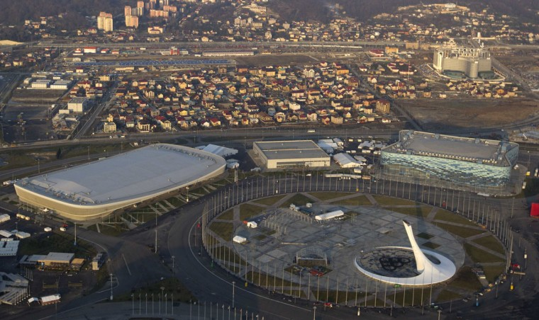 "An aerial view from a helicopter shows the Olympic Park under construction in the Adler district of the Black Sea resort city of Sochi, December 23, 2013. Sochi will host the 2014 Winter Olympic Games in February. The view shows the ""Adler Arena"" (L), the ""Iceberg"" Skating Palace (R) and the Sochi Medals Plaza (bottom). Picture taken December 23, 2013."