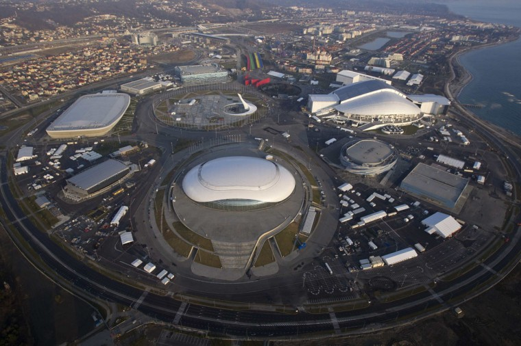"An aerial view from a helicopter shows the Olympic Park under construction in the Adler district of the Black Sea resort city of Sochi, December 23, 2013. Sochi will host the 2014 Winter Olympic Games in February. The view shows (clockwise from R, top) the ""Fisht"" Olympic Stadium, the ""Shayba"" Arena, the ""Bolshoy"" Ice Dome, the ""Ice Cube"" Curling center, the ""Adler Arena"" and the ""Iceberg"" Skating Palace. Picture taken December 23, 2013."
