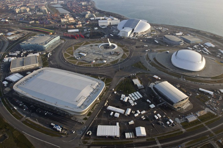"An aerial view from a helicopter shows the Olympic Park under construction in the Adler district of the Black Sea resort city of Sochi, December 23, 2013. Sochi will host the 2014 Winter Olympic Games in February. The view shows (clockwise from C, top) the ""Fisht"" Olympic Stadium, the ""Shayba"" Arena, the ""Bolshoy"" Ice Dome, the ""Ice Cube"" Curling center, the ""Adler Arena"" and the ""Iceberg"" Skating Palace. Picture taken December 23, 2013."