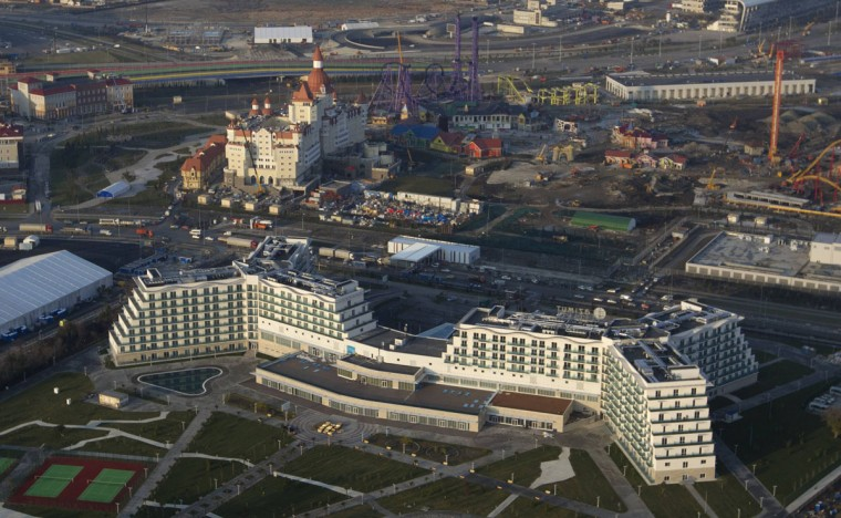 "An aerial view from a helicopter shows AZIMUT Hotel Resort and SPA Sochi (bottom) and the ""Theme Park / Amusement Park"" (top) constructed by the JSC ""Sochi Park"" company in the Adler district of the Black Sea resort city of Sochi, December 23, 2013. Sochi will host the 2014 Winter Olympic Games in February. Picture taken December 23, 2013."
