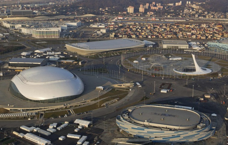 "An aerial view from a helicopter shows the Olympic Park under construction in the Adler district of the Black Sea resort city of Sochi, December 23, 2013. Sochi will host the 2014 Winter Olympic Games in February. The view shows (clockwise from R, bottom) the ""Shayba"" Arena, the ""Bolshoy"" Ice Dome, the ""Ice Cube"" Curling center and the ""Adler Arena"", with the Main Media Center building (L, top) seen in the background. Picture taken December 23, 2013."