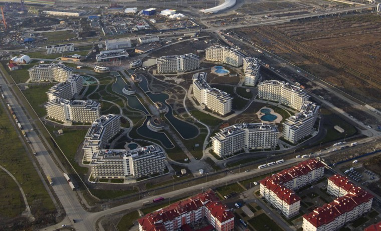 An aerial view from a helicopter shows hotels and residential houses recently constructed for the 2014 Winter Olympics in the Adler district of the Black Sea resort city of Sochi, December 23, 2013. Sochi will host the 2014 Winter Olympic Games in February. Picture taken December 23, 2013.