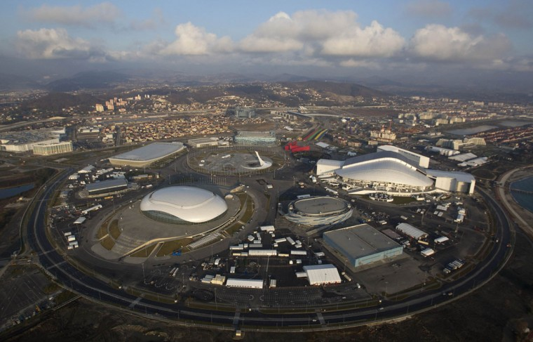 "An aerial view from a helicopter shows the Olympic Park under construction in the Adler district of the Black Sea resort city of Sochi, December 23, 2013. Sochi will host the 2014 Winter Olympic Games in February. The view shows (clockwise from R) the ""Fisht"" Olympic Stadium, the ""Shayba"" Arena, the ""Bolshoy"" Ice Dome, the ""Ice Cube"" Curling center, the ""Adler Arena"" and the ""Iceberg"" Skating Palace. Picture taken December 23, 2013."