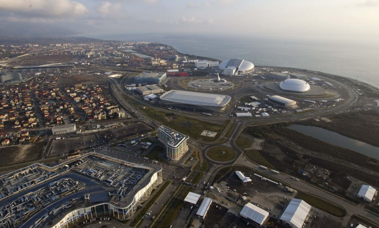 An aerial view from a helicopter shows the Olympic Park (R, top) and under construction and the Main Media Center building (L, bottom) in the Adler district of the Black Sea resort city of Sochi, December 23, 2013. Sochi will host the 2014 Winter Olympic Games in February. Picture taken December 23, 2013.