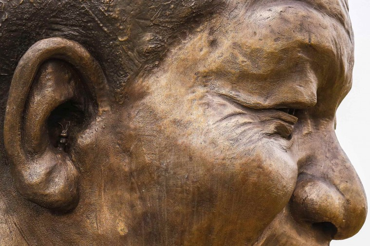 "A tiny rabbit is seen in the right ear of a 9-metre (30-feet) bronze statue of the late former South African President Nelson Mandela in Pretoria, January 21, 2014. The rabbit, which has yet to be removed, was placed by the sculptors as a ""small trademark"" after being told they were not allowed to add their signatures to the trousers of the nine-metre bronze statue, according to local media. They said the rabbit symbolised the tight deadline they were working under, as ""haas"" (rabbit) in Afrikaans also translated as haste, the local newspaper reported. Picture taken January 21, 2014. (REUTERS/Stringer)"