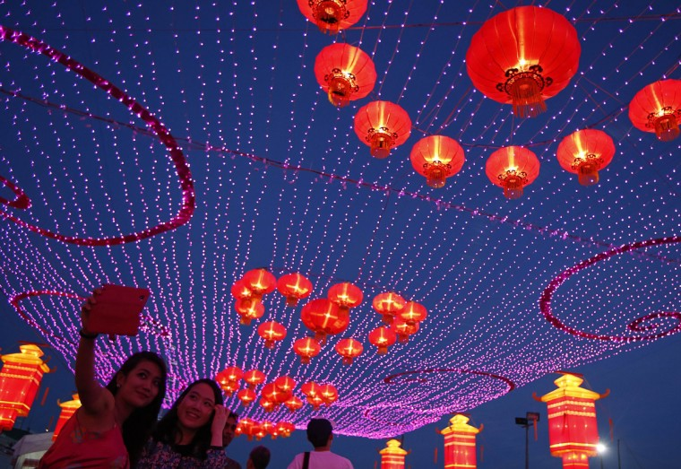 Revelers take photos of themselves during Chinese New Year celebrations ahead of the new year at Marina Bay in Singapore. The Lunar New Year which falls on January 31 marks the year of the horse. (Edgar Su/Reuters)