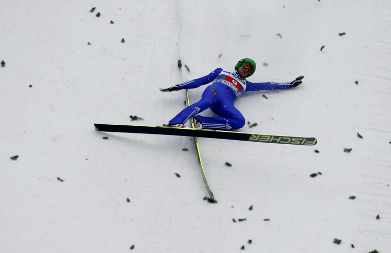 Russia's Denis Kornilov crashes during the second run of the third jumping of the four-hills tournament in Innsbruck, January 4, 2014. Finland's Anssi Koivuranta won ahead of Switzerland's Simon Ammann and Poland's Kamil Stoch. The competition was cancelled on Saturday after only one round due to wind conditions. The prestigious four-hills tournament will end in Bischofshofen on January 6. (REUTERS/Dominic Ebenbichler)