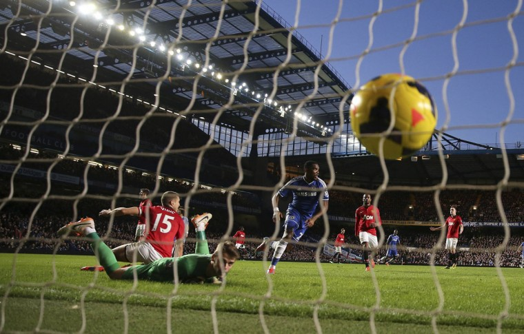 Chelsea's Samuel Eto'o (center) celebrates after scoring his side's second goal during an English Premier League soccer match against Manchester United at Stamford Bridge in London, January 19, 2014. (Eddie Keogh/Reuters)