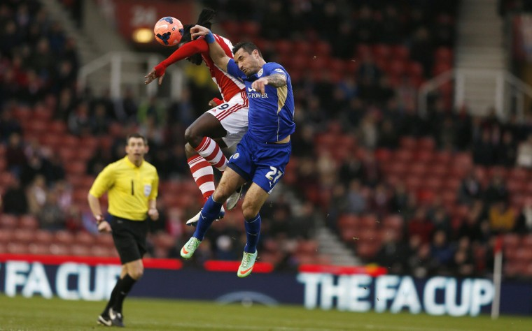 Leicester City's Marcin Wasilewski (R) challenges Stoke City's Kenwyne Jones during their English FA Cup third round soccer match at the Britannia stadium in Stoke-on-Trent, central England January 4, 2014. (REUTERS/Stefan Wermuth)