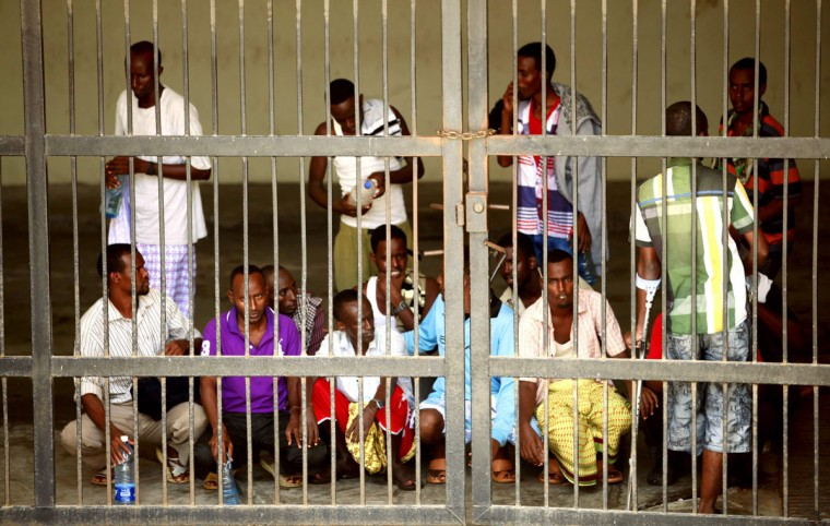Suspected Somali pirates captured by the Dutch navy working under NATO command are seen behind bars at the Mombasa Law Courts in the Kenyan coastal city of Mombasa, January 23, 2014. A Kenyan court sentenced 24 Somalis to seven years each in prison on Thursday for attempting to hijack an Iranian merchant vessel, FV Ariya, in the Gulf of Oman in October 2010. The men were handed over to Kenyan authorities because Somalia, which is struggling to rebuild after two decades of civil war, was not seen as stable enough to try them properly. (REUTERS/Joseph Okanga)