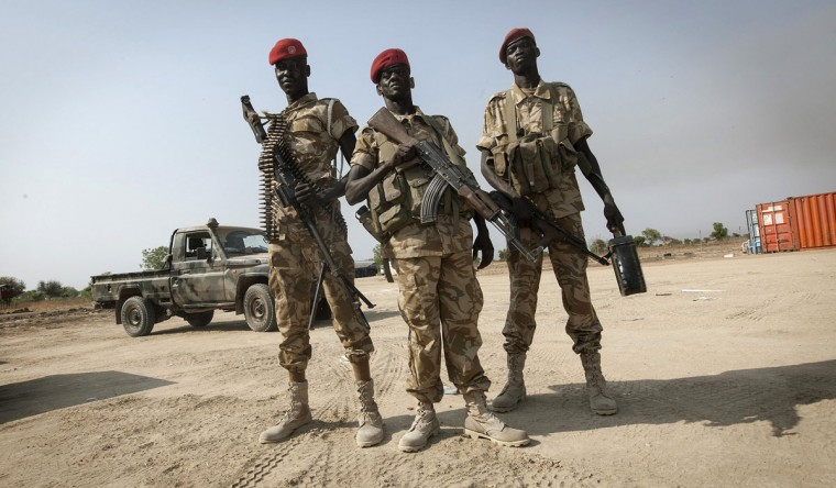 Sudan People's Liberation Army soldiers secure Bor airport, 124 miles north of Juba, a day after its recapture by government SPLA forces January 19, 2014. South Sudanese government forces said they seized the flashpoint town of Bor back from rebels on Saturday. (George Philipas/Reuters)