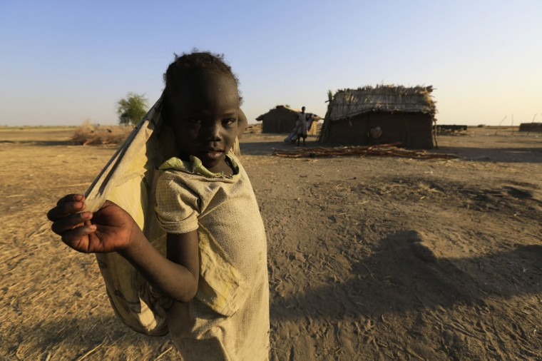 A South Sudanese girl looks on near a shelter in al-Ghanaa village in the Jableen locality in Sudan's White Nile State, as refugees arrive from the South Sudanese war zones of Malakal and al-Rank via the Joda border, January 17, 2014. REUTERS/Mohamed Nureldin Abdallah