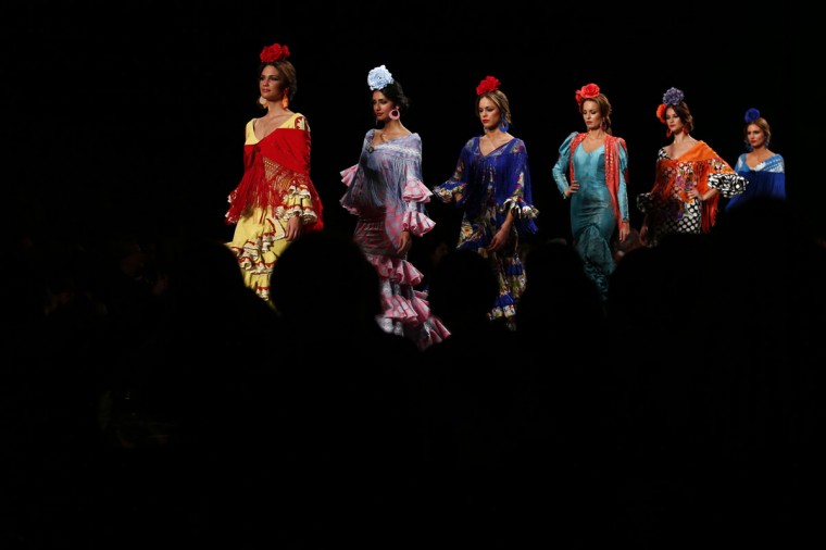 Models present creations by Mari Carmen Cruz during the International Flamenco Fashion Show SIMOF in the Andalusian capital of Seville January 31, 2014. The show will run until February 2. (REUTERS/Marcelo del Pozo)