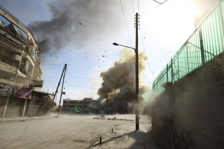 Smoke rises at a site hit by what activists said were barrel bombs dropped by government forces in the Al-Ansari neighborhood of Aleppo January 31, 2014. (REUTERS/Ammar Abdullah)