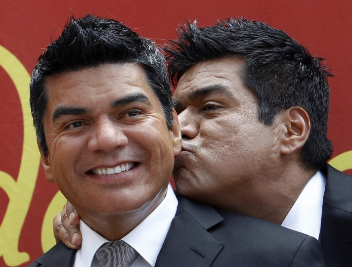 Actor and comedian George Lopez (R) kisses his wax figure at Madame Tussauds in Hollywood, California on April 1, 2010. (Mario Anzuoni/Reuters)
